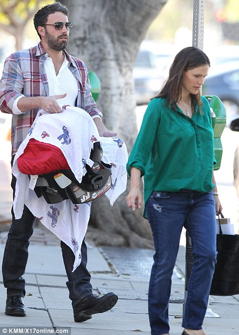 Casual: The mother-of-three kept it simple for the trip but added glamour with the jewel coloured shirt