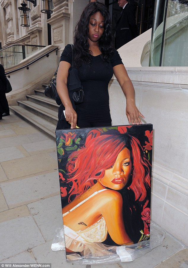 Ready: Rihanna's fan waited outside the hotel until the singer signed her name in gold pen when she was confronted with the painting