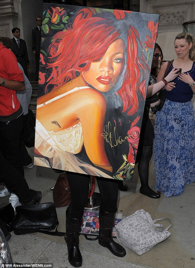 Signed: A fan was left delighted when Rihanna put her autograph on a large painting of the star
