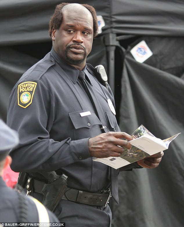 An arresting sight: Shaquille O'Neal donned a comedy wig as he recorded scenes for Grown Ups 2 in Massachusetts today
