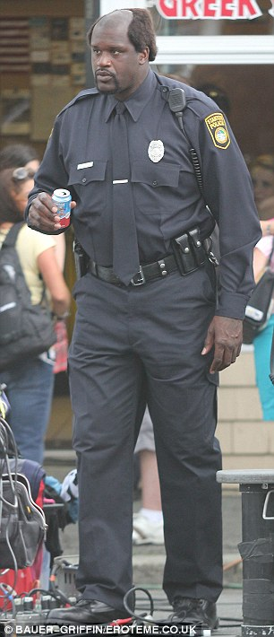 In need of a bigger can: The former basketball star's soft drink looked ridiculously small in his giant hands