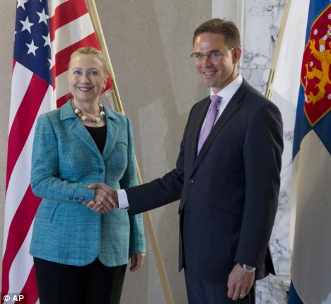 U.S. Secretary of State Hillary Rodham Clinton meets with Finnish Prime Minister Jyrki Katainen in Helsinki at the start of her visit which will focus on the Syrian bloodshed