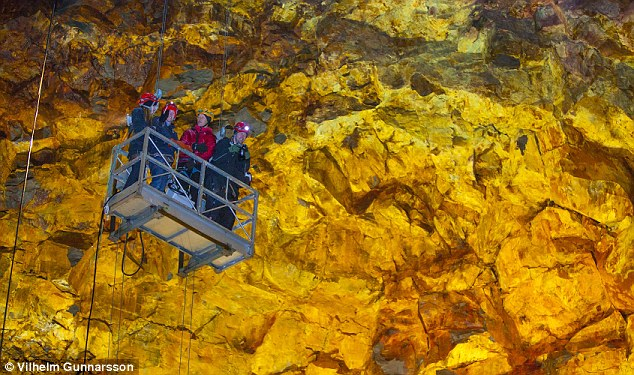 Visitors are lowered into the lava chamber by a crude lift