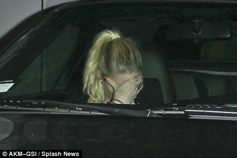 Something to hide? Actress Amber Heard shields her face while leaving the Chateau Marmont hotel in Los Angeles on Monday night