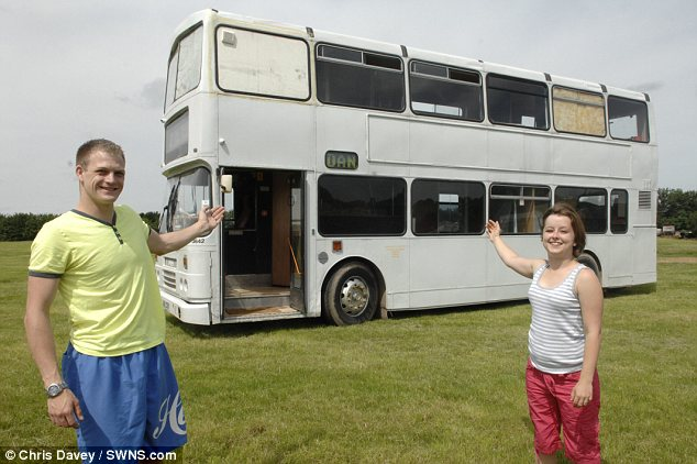 Big bus: Daniel Bond, 28, spent four gruelling months and £11,000 turning the neglected vehicle into a luxury two bedroom home with girlfriend, Stacey Drinkwater, 20