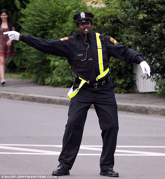In command: Shaq was also seen directing traffic as part of his role
