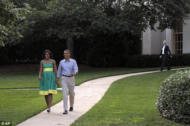 Pending outcome: Obama, walking with his wife, has a long road ahead of him as the White House is bracing itself for a dismal day on Thursday