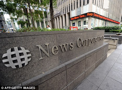 Split: The News Corp board approved a plan to carve the conglomerate into distinct entertainment and publishing businesses