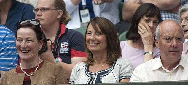 Like mother, like daughter: Carole also chose navy and white when she attended Wimbledon yesterday. Carole did not sit in the royal box, instead joining her friends in the stands