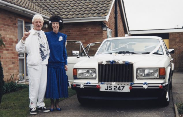 Happy: Janet Cope, right, with Jimmy Savile on her wedding day