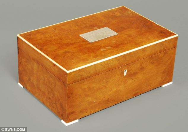 Classy: A Dunhill walnut humidor presented to Sir Jimmy in 1976 is estimated at £300 to £500