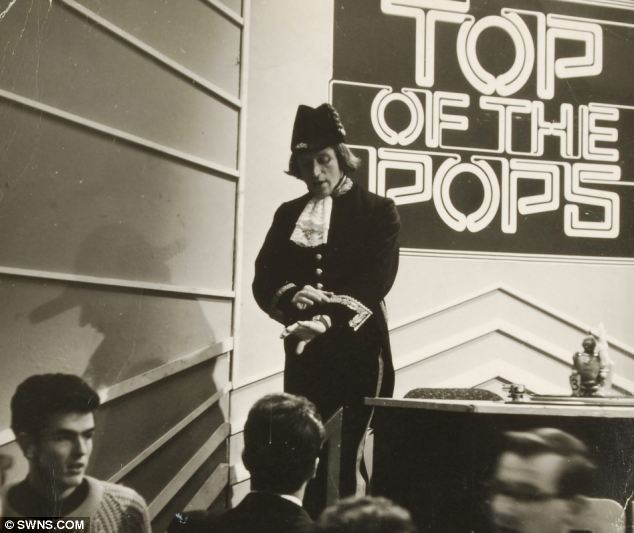 Style never sleeps: Photo showing Sir Jimmy Savile in his Naval Officers dress uniform on Top of the Pops. Estimated auction value of suit  £300-£500.