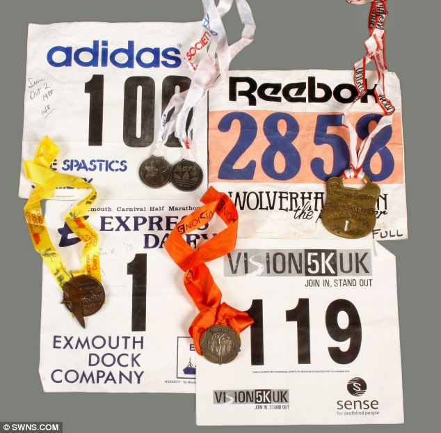 Marathon runner: A selection of Sir Jimmy's medals from various running events