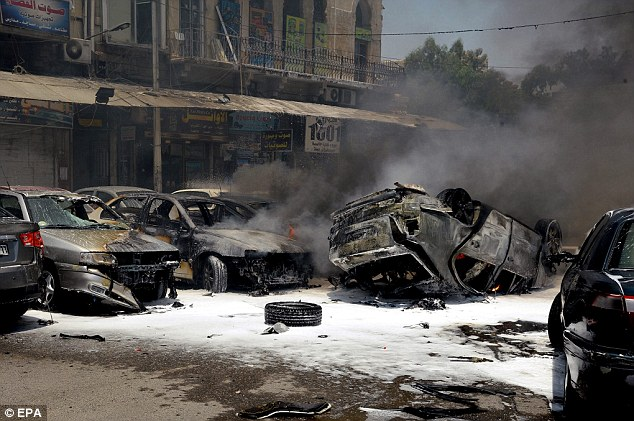 Wreckage: Syria's state-run TV said the explosion was in the car park of the Palace of Justice, a compound that houses several courts