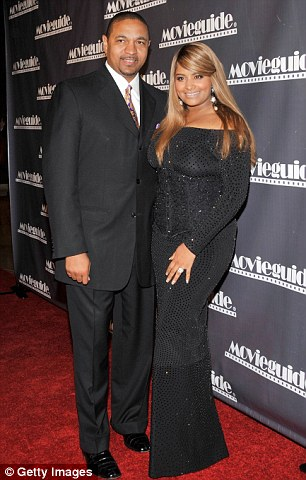 Victim: NBA coach Marcus Jackson, pictured with wife of 22 years Desiree Coleman, was at the center of an extortion scam by a stripper he was having an affair with