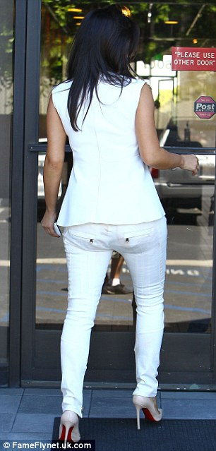 White light, white heat: The reality star's simple ensemble showed off Kim's curvy figure to the maximum