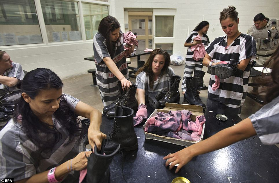 Pride in appearance: The women clean the dust off their heavy-duty work boots after a day of working in the desert of Maricopa County