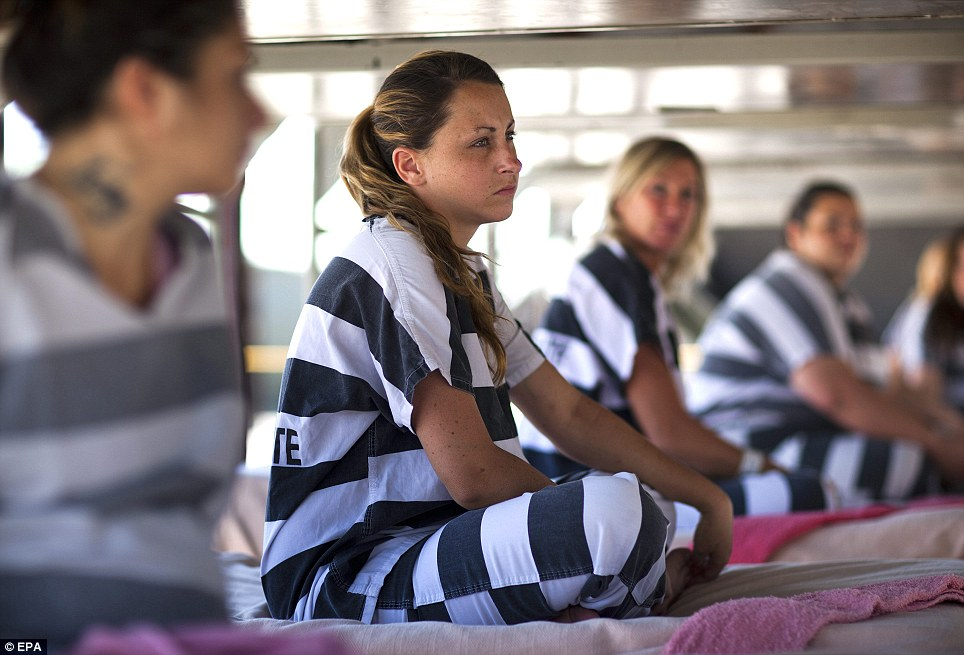 Hard lessons: Kelly DeGrose (C), along with other inmates, listens to a detention officer lecture them
