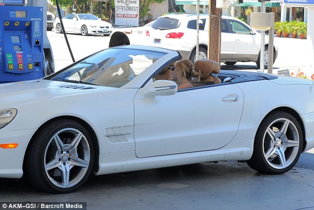 Riding in cars: Miley took the wheel as she and her friend went on a burger hunt