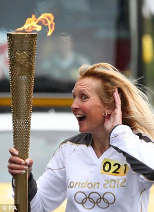 Special occasion: Michelle Brown carried the torch through the Lincolnshire town in Wednesday