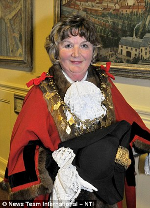 Obscene: The costume worn by Louth's female town Mayor, Jill Makinson-Sanders raised more than a few chuckles when she wore it to greet the Olympic torch recently