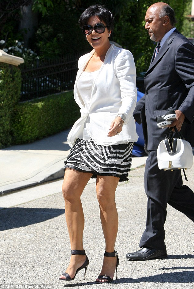 Looking after mom: The couple dropped off Kim's mother Kris Jenner at home before they visited the centre