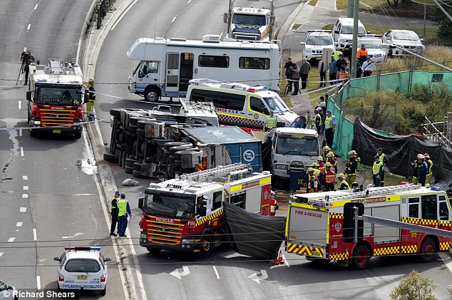 Firefighters and police were said to be in 'disbelief' when they arrived at the scene of the accident, pictured, which happened at traffic lights in Sydney