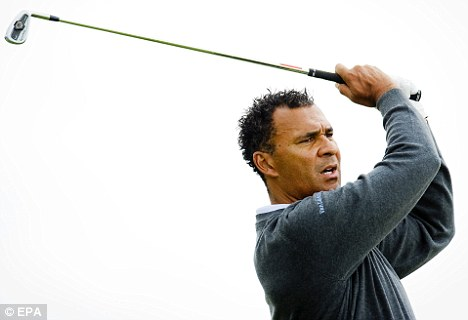 Favourite: Gullit takes in a round of golf in his homeland