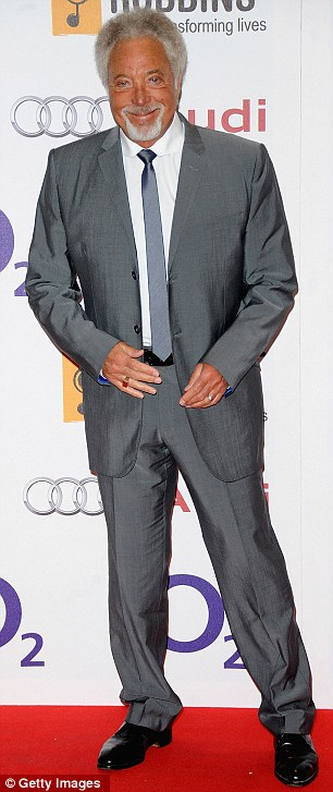 The boys are in the house: Sir Tom Jones was a guest at the bash alongside Norman Cook who was more Sweaty Boy Slim as he posed for pictures on the red carpet