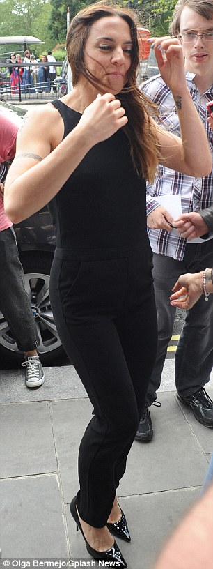Blown away: Melanie C encountered some trouble with the wind as she made her arrival