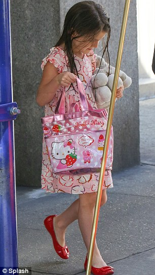 Separate lives: Katie and her daughter Suri were spotted in New York yesterday