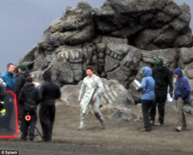 Out of this world: Tom Cruise, above, on the set of Oblivion, his new £100million sci-fi thriller