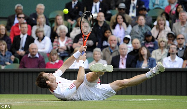 Flat out: Murray has slipped three times already as he faces Baghdatis on Centre Court