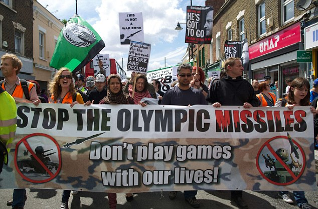 Protest: Angry residents in east London march through Bow to protest against plans to station surface-to-air missiles on the roof of their rented flats for the Olympics