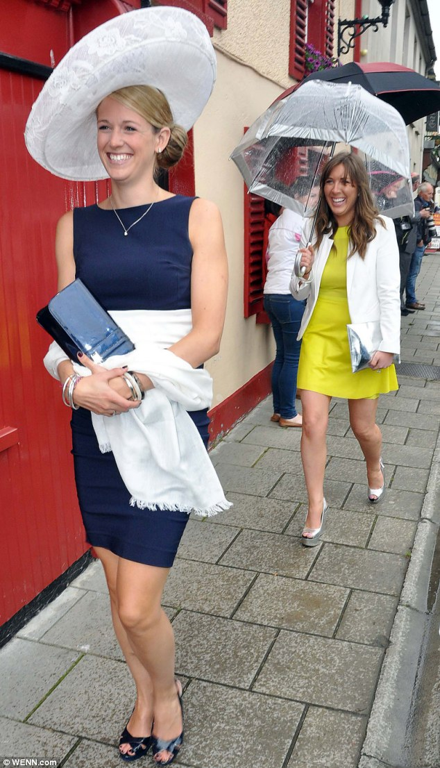 Glamorous: Guests didn't let the rain dampen their spirits or their style at the wedding of Una and Ben in Thurles