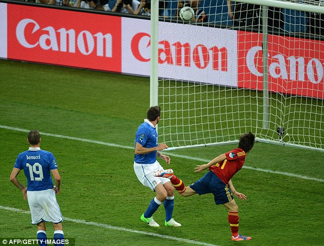 Headmaster: David Silva heads Spain into the lead in the 14th minute