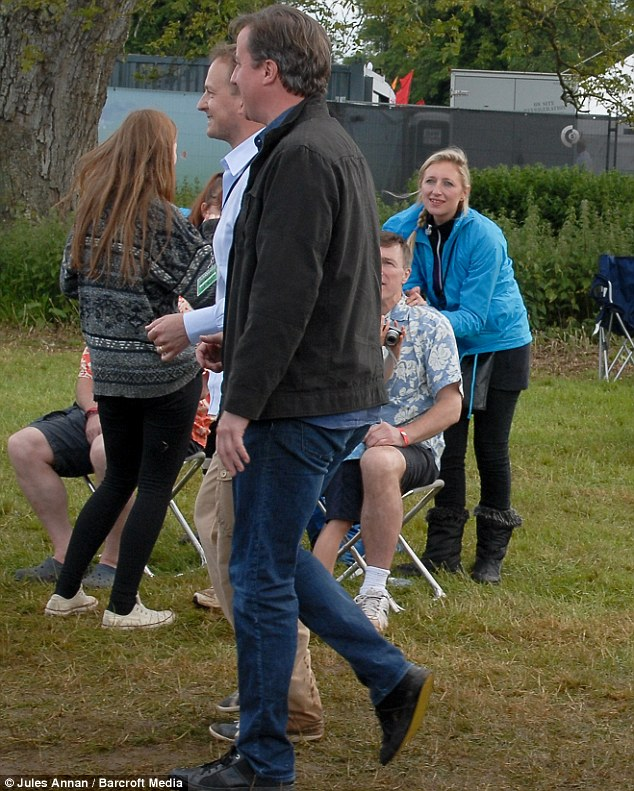 Day out: Mr Cameron was dressed casually in blue jeans and a brown jacket as he attended the festival near his constituency home