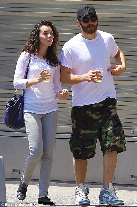 The pair picked up beverages to cool themselves down as they strolled around New York City