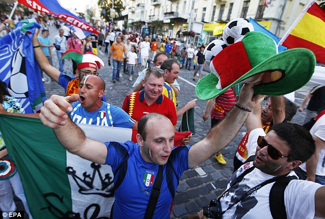 Not to be left out: Italian fans show their support before the start of the game