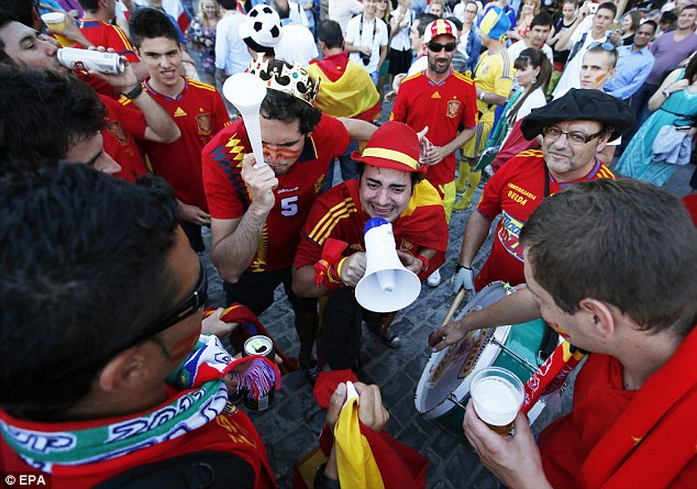 Orchestrating support: Spain fans bang the drum and take to the megaphone to get behind their team