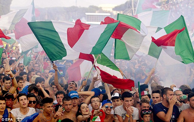 Back in Rome: Italian supporters cheer for their team before watching the final of the UEFA EURO 2012 between Spain and Italy in the ancient Roman chariot racing stadium 'Circo Massimo'