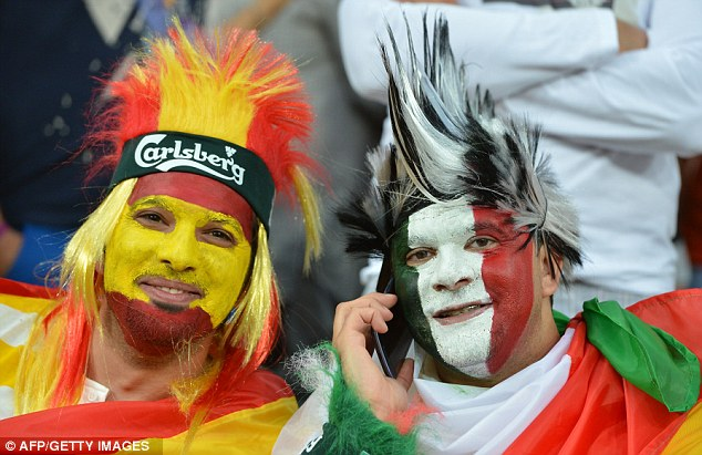 United: A Spanish and Italian go to great lengths to show support for their respective side but are happy to sit together at the showpiece final