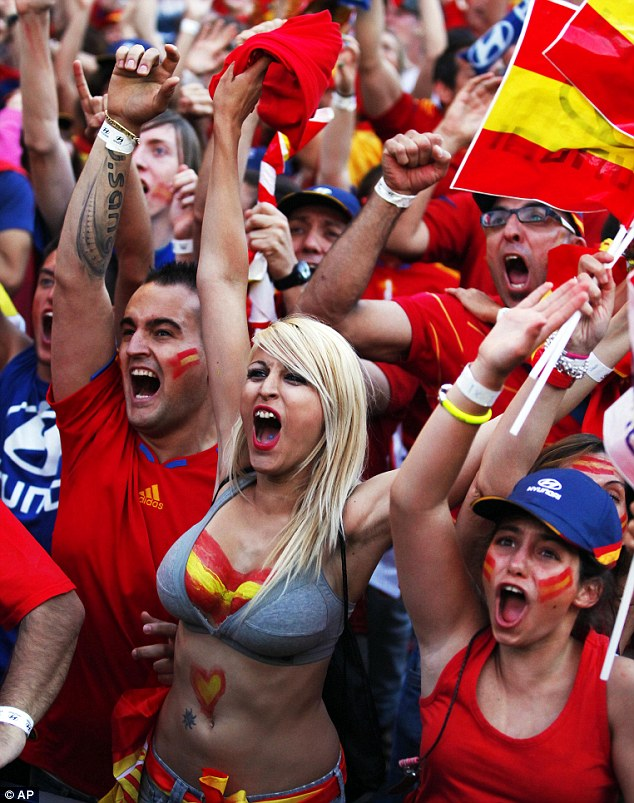 Winners: Spanish fans celebrate during the Euro 2012 final as their side win in style
