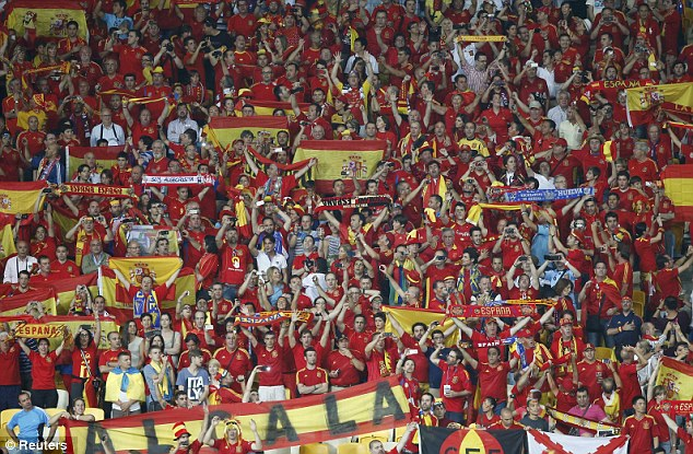 Stylish: Spain's soccer fans cheer during their emphatic 4-0 win