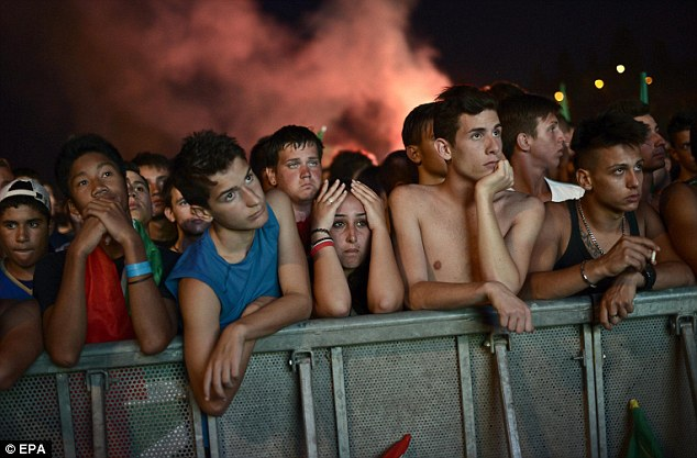 Heartbreaking: Dejected Italian supporters at a public viewing at the ancient Circus Maximus in central Rome