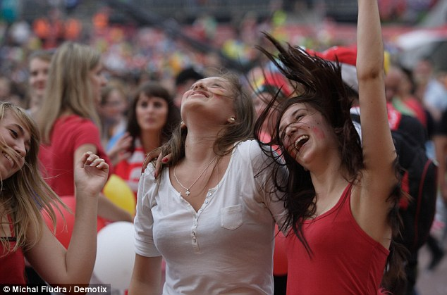 Party time: Fans with painted faces dancing as Spain romp to victory in the Gdansk's Fan Zone, in Poland, where Spain played their group games
