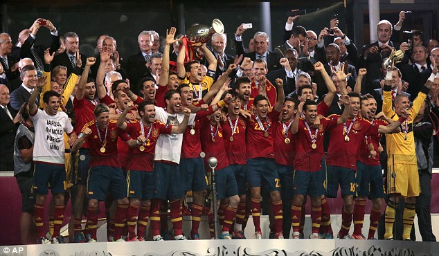Champions: Spain's players celebrate with the trophy after winning the final of Euro 2012
