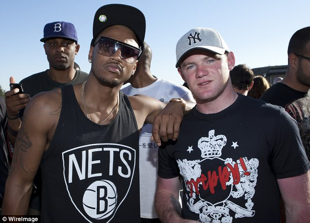 Making new friends: Wayne was seen posing with singer Trey Songz at the daytime party