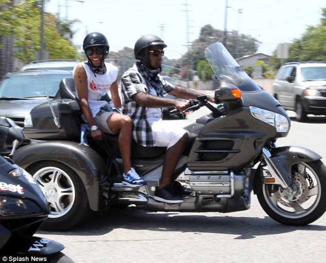 Nice ride: Cole was seen on the back of a huge three-wheel bike