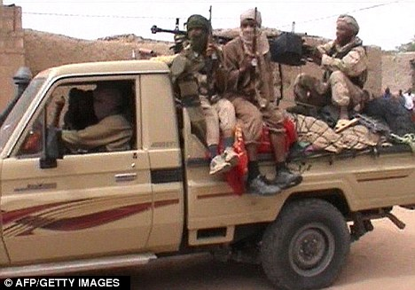 Overrun: A pick up truck carrying fighters of the Islamist group Ansar Dine drive through Timbuktu during troubles last month